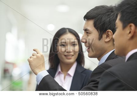 Business People Looking at Wall