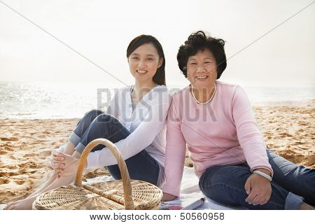 Grandmother and Granddaughter Picnicking at the Beach