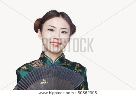 Young Woman in Qipao with Fan