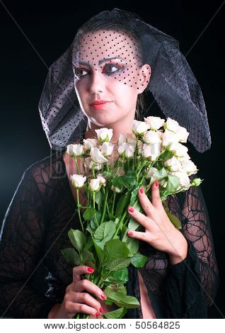 Girl In A Black Veil With Pink Roses