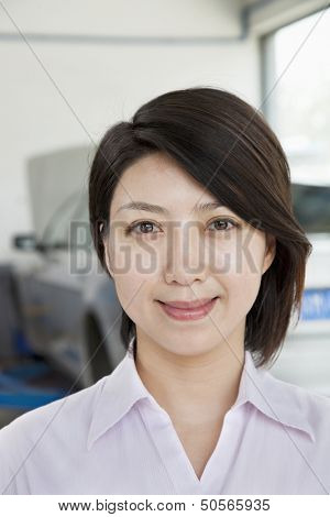 Portrait of Businesswoman at Car Repair Garage