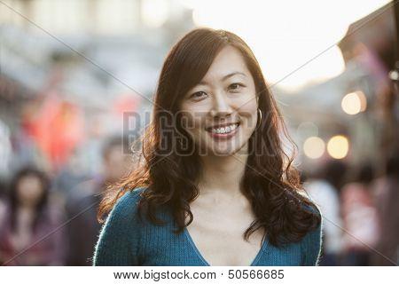 Portrait Of Smiling Mid Adult Woman In Houhai, Beijing