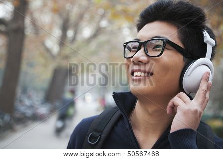 Student listening to music on college campus