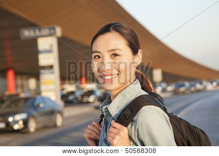 Young traveler portrait outside of airport