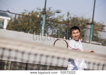 Adult men playing tennis