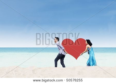 Asian Couple Bring Heart Card At Beach