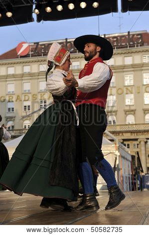 ZAGREB,CROATIA - JULY 19: Members of folk groups Oberes Murtal from Austria during the 47th International Folklore Festival in center of Zagreb,Croatia on July 19,2013