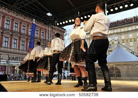 ZAGREB,CROATIA - JULY 19: Members of folk groups Domizan in Czech folk costume during the 47th International Folklore Festival in center of Zagreb,Croatia on July 19,2013