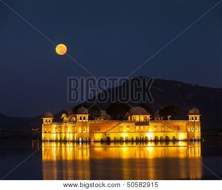 Rajasthan landmark - Jal Mahal (Water Palace) on Man Sagar Lake at night in twilight.  Jaipur, Rajasthan, India