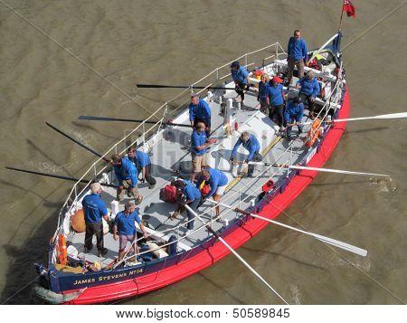 LONDON- SEPT 7: Crews rowing between tower and london bridges, visit london during thames river week, LONDON, SEPT 7, 2013