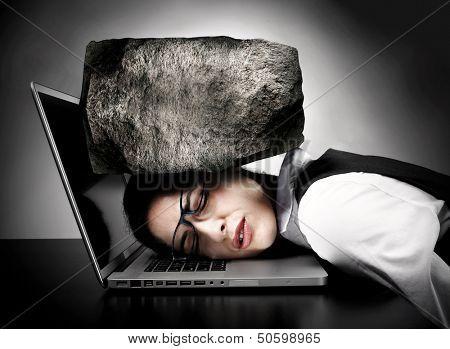 Woman programmer with laptop having stress. Headache.
