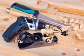 stock photo of work bench  - Woodworking and tools on work bench with shavings