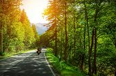 stock photo of recreational vehicles  - Biker on mountainous road in sunset light - JPG