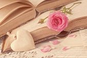 pic of vase flowers  - Pink flowers letters and old books on a table - JPG
