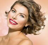 Beauty Young Woman Portrait Closeup. Beautiful Model Girl Face. Short Curly Hair, Fresh Clean Skin a