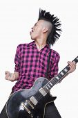 image of half-shaved hairstyle  - Young man with punk Mohawk playing guitar - JPG