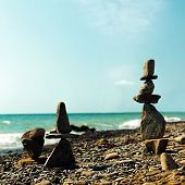 stock photo of fulcrum  - Pebble tower abstract marine still life for your design - JPG