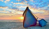 stock photo of rough-water  - blue fisherman boats and sunrise - JPG