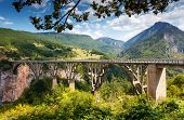 Old big bridge in Durdevica and fantastic view Tara river gorge - is the biggest one canyon in Europe in the national park Durmitor, Montenegro. Balkans. Beauty world. poster