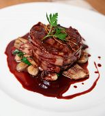 stock photo of chateaubriand  - Tenderloin steak wrapped in bacon with demi - JPG