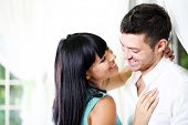 stock photo of amor  - Beautiful young romantic couple near window - JPG