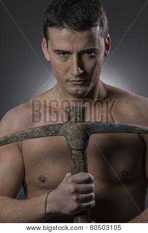 Craftman, Construction worker portrait holding a peak.