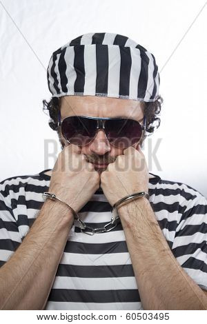 Penitentiary, Desperate, portrait of a man prisoner in prison garb, over white background
