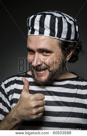 Imprisoned, Desperate, portrait of a man prisoner in prison garb, over white background