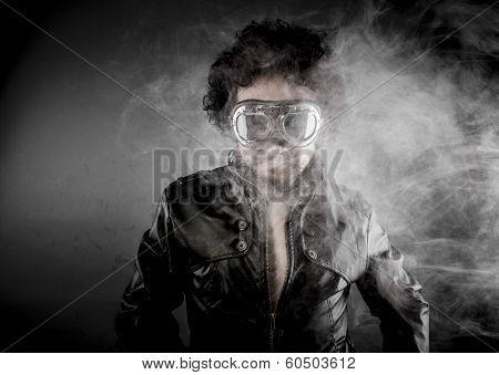 Motorcyclist, biker with sunglasses era dressed Leather jacket, huge smoke over dark background