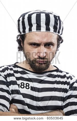 Desperate, portrait of a man prisoner in prison garb, over white background