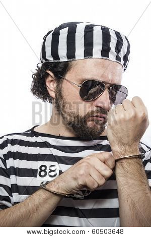 Lawbreaker, Desperate, portrait of a man prisoner in prison garb, over white background