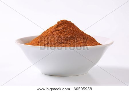 pile of cinnamon powder in a bowl