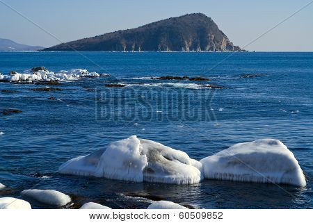 Small Island In Winter Sea