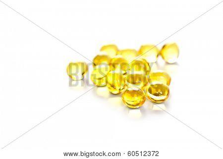 yellow gelatin pills on white background