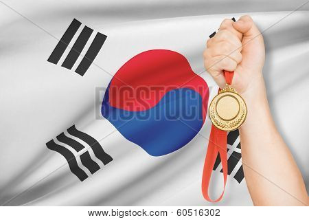 Medal In Hand With Flag On Background - South Korea