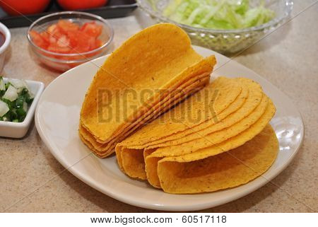 Taco Shells on a Plate with Some Ingredients