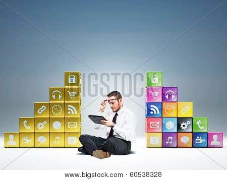man with tablet and icons cubes background