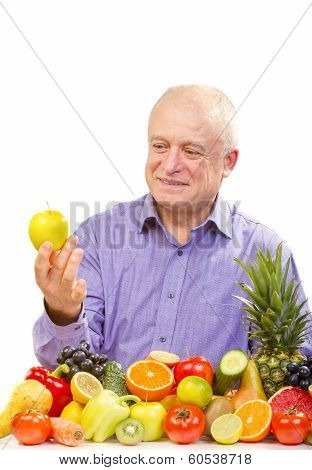 Senior man holding a green apple