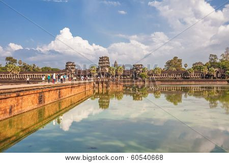 SIEM REAP, CAMBODIA - NOVEMBER 15, 2011:  Tourists go to the temple of Angkor Wat. Angkor Wat is a Hindu, then subsequently Buddhist temple complex and the largest religious monument in the world.