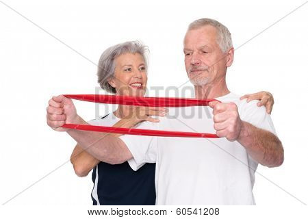 Active senior couple in front of white background