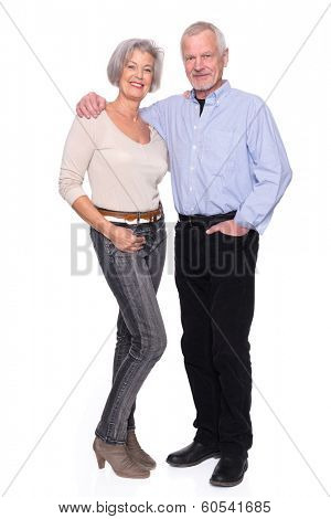 Smiling senior couple in front of white background