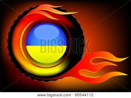 Burning car tire and Ukrainian flag