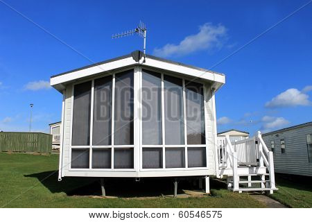 Scenic view of modern trailer on caravan park in summer.