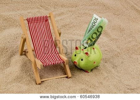 beach chair with euro currency on the sandy beach. symbolic photo for travel costs, vacation, holiday