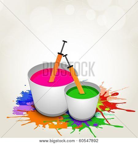 Indian colour festival Happy Holi celebrations concept with buckets full of water colours and pickari on splash background.
