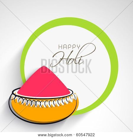 Indian festival Happy Holi celebrations concept with pink colour powder on grey background.