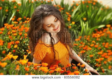 Enjoyment. Free Happy Woman Enjoying Nature. Freedom Concept. Beauty Girl Over Marigold Flowers Fiel