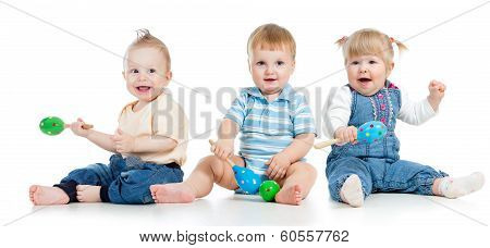 Babies Playing With Musical Toys. Two Boys And Girl With Maracas Isolated On White Background
