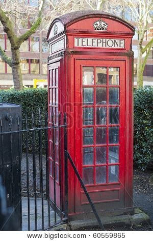 Old red telephone booth in Smithfield meat market in London, UK