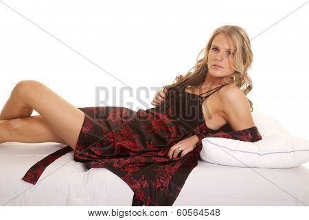 Woman Black And Red Nightgown Lay On Back Looking